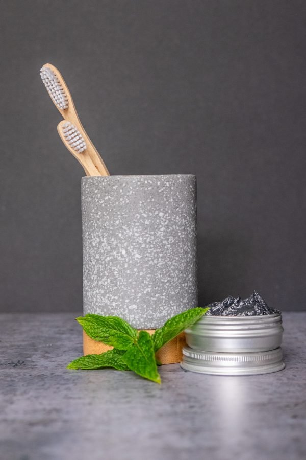 bamboozles bamboo toothbrushes in a toothbrush holder with a 50g tin of natural charcoal whitening Toothpaste