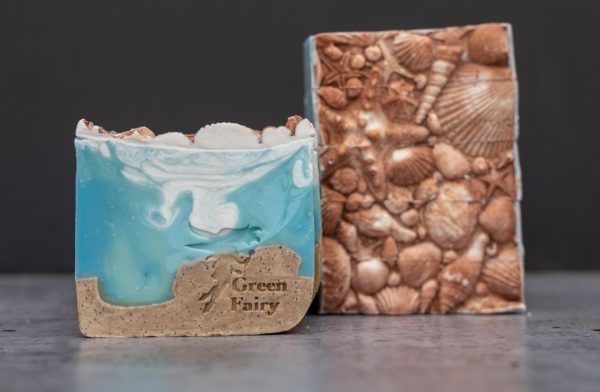 Soap slice that looks like the sand and the sea topped with sea shell details
