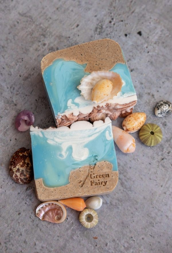 Soap slice that looks like sand and sea and topped with soap shell details